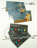 3 of your business cards turned into luggage tags with grommets and stainless steel cables.